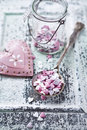 Valentine s cake decorations on a spoon heart shaped an old Royalty Free Stock Images