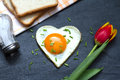Valentine's Day abstract breakfast with egg heart and tulip Royalty Free Stock Photo