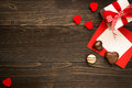 Valentine`s Day background. Gift box, red hearts and Valentine`s