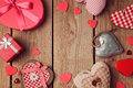 Valentine's day background with heart shapes on wooden table. View from top