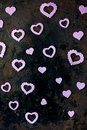 Valentine's day background - purple hearts confetti on black rustic background Royalty Free Stock Photo