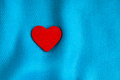 Valentine s day background red heart on blue folds cloth decorative abstract wavy or textile elegant material Royalty Free Stock Photos