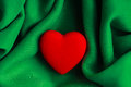 Valentine s day background red heart on green folds cloth decorative abstract wavy or textile elegant material Stock Photography