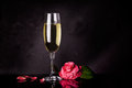 Valentine s day card glass of champagne with flower for Stock Photos