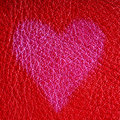 Valentine's day card. Heart love symbol on red leather background Royalty Free Stock Photo