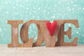 Valentine`s day concept with wooden letters love and heart shape over bokeh background Royalty Free Stock Photo