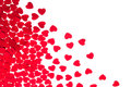 Valentine`s day decorative border of red hearts confetti isolated on white background. Royalty Free Stock Photo
