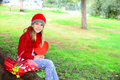 Valentine s day girl holding large heart beautiful blond with red crochet hat and felt hat in her hands and red wicker picnic Stock Image