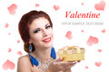 Valentine s day golden gift box for your beloved on of the young beautiful girl Royalty Free Stock Images