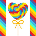 Valentine`s Day Heart shaped candy lollipops with bow, colorful spiral candy cane with bright rainbow stripes. on stick with twist Royalty Free Stock Photo