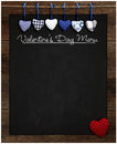 Valentine s day menu chalkboard blue and red gingham love hearts hanging on wooden frame with blackboard dotted heart in Royalty Free Stock Image