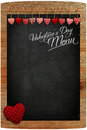 Valentine s day menu chalkboard fabric love hearts hanging on wo wooden texture background big red heart in corner copy space for Royalty Free Stock Photos