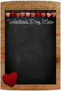 Valentine s day menu chalkboard fabric love hearts hanging on wo wooden texture background big red heart in corner copy space for Stock Photography