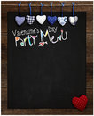 Valentine s day party menu chalkboard blue and red gingham love hearts hanging on wooden frame with blackboard dotted heart in Royalty Free Stock Photography