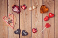 Valentine's day rustic background with heart shapes on wooden table. Royalty Free Stock Photo