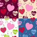 Valentine s day seamless patterns a pattern with st valentines or saint hearts in four different versions useful also as design Stock Photos