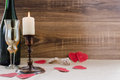 Valentine`s Day. wine, candles, small heart Royalty Free Stock Photo