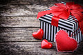 Valentine s gift box with red hearts on wooden background Stock Image