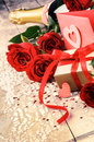 Valentine's setting with present and red roses Royalty Free Stock Photo