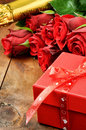Valentine's setting with red roses, champagne and gift box Royalty Free Stock Photo