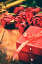 Valentine's setting with red roses and gift box Royalty Free Stock Photo