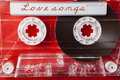 Valentine theme valentines day card vintage audio cassette on red background Stock Images