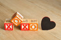 Valentine's Day.XOXO Spelled with colorful alphabet blocks Royalty Free Stock Photo