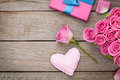 Valentines day background with gift box full of pink roses and h Royalty Free Stock Photo