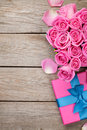 Valentines day background with gift box full of pink roses Royalty Free Stock Photo