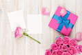Valentines day background with gift box full of pink roses and t Royalty Free Stock Photo