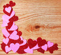Valentines day background glitter red and pink hearts on wooden texture Stock Images
