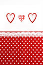 Valentines Day background with hand made hearts and red  fabric background Royalty Free Stock Photo