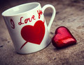Valentines day background red heart and mug on wooden Royalty Free Stock Photo