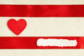 Valentines day background red satin ribbon and heart with wooden on cloth copy space for text Royalty Free Stock Image