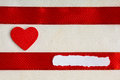 Valentines day background red satin ribbon and heart with wooden on cloth copy space for text Royalty Free Stock Photography