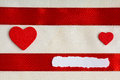 Valentines day background red satin ribbon and hearts with two wooden on cloth copy space for text Royalty Free Stock Photos