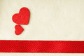 Valentines day background red satin ribbon and hearts with two wooden on cloth copy space for text Royalty Free Stock Images