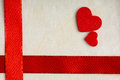 Valentines day background red satin ribbon and hearts with two wooden on cloth copy space for text Stock Photos