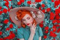 Valentines Day background. Spring bloom rose flower garden. Fabulous lady with red nails in dress. Trendy summer hat. Awesome