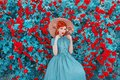 Photo : Valentines Day background. Spring rose flower garden. Fabulous lady with red lips in dress. Gardening on farm. Awesome flower wall roses farm woman