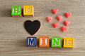 Valentines Day. Be Mine Spelled with colorful alphabet blocks Royalty Free Stock Photo
