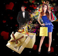 Valentines day beauty young happy girl with golden gift box and elegant man in smoking with flying valentine hearts love concept Stock Photos