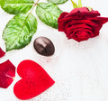 Valentines day border with big red heart roses and chocolate on white wooden background Stock Photo