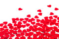 Valentines day border of red hearts confetti with copy space on white background. Royalty Free Stock Photo