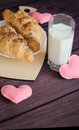 Valentines day breakfast croissants with milk Royalty Free Stock Photo