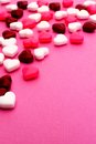Valentines day candy background border on a pink textured Stock Image