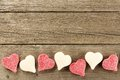 Valentines Day candy border on wood background Royalty Free Stock Photo