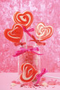 Valentines day candy in jar happy glass with red heart shape lollipops and jelly hearts on pink wood background Royalty Free Stock Photo