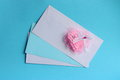 Valentines day card pink heart stock photos on love letter white envelopes on light blue green background Stock Images
