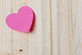 Valentines day card with sticky note in the shape of a heart on a wooden background Royalty Free Stock Photo
